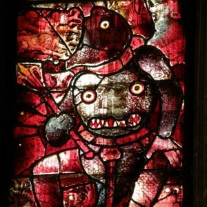 Detail of Stained Glass window from Fairford church depicting a demon