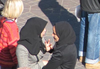 Two Muslim women talking (detail from Marrakech market image)