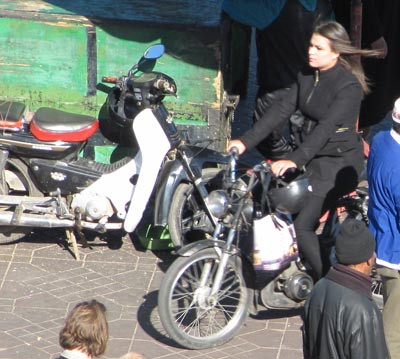 GIrl on scooter (detail from Marrakech market image)