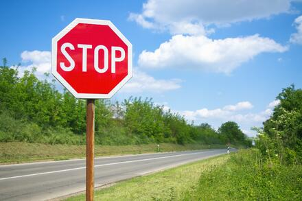 Stop sign by side of road